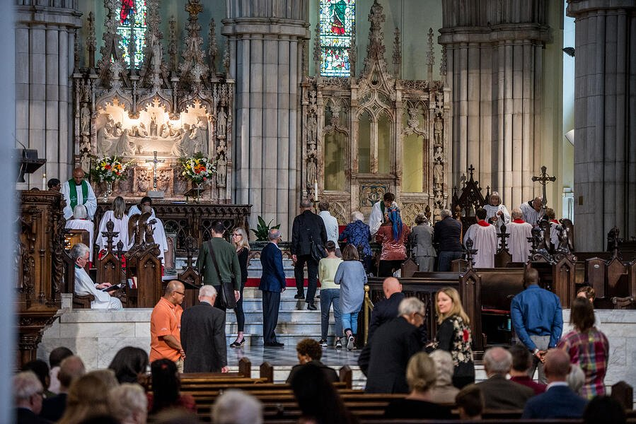 People approaching the altar in a church for communion